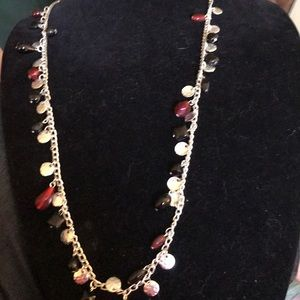 Silver necklace. Red black stones